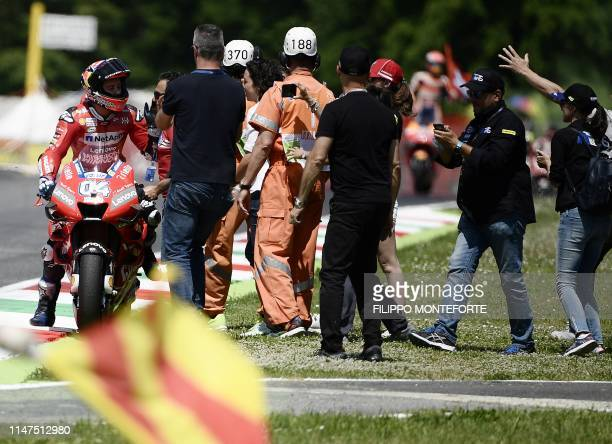 Italy's Andrea Dovizioso celebrates with his team after placing third of the Italian Moto GP Grand Prix at the Mugello race track on June 2 2019 in...
