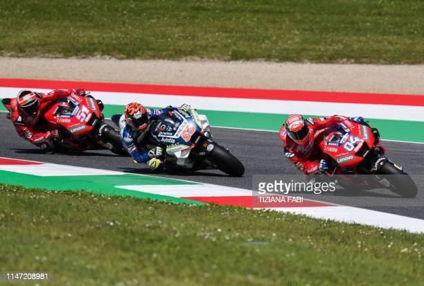 Italy's Andrea Dovizioso rides his Ducati followed by Spain's Esteve Rabat riding his Ducati and Italy's Michele Pirro riding his Ducati during free...
