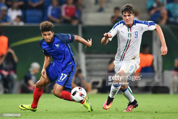 Italy's Andrea Favilli and France's Denis Will Poha vie for the ball during the UEFA European Under19 Championship final soccer match between France...