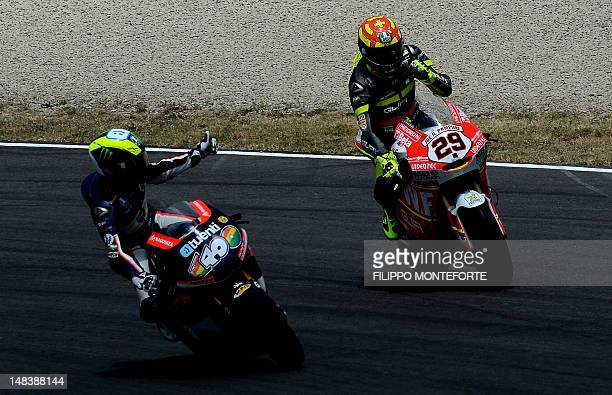 Italy's Andrea Iannone celebrates after winning the Italian Moto2 race on the Mugello Circuit near Scarperia on July 15 2012 Iannone won ahead of...