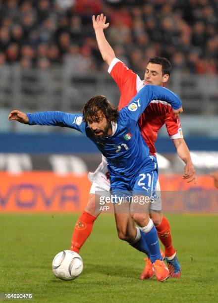 Italy's Andrea Pirlo is challenged by Malta's Gareth Sciberras during their World Cup Qualifier football match at the National Stadium in Malta on...