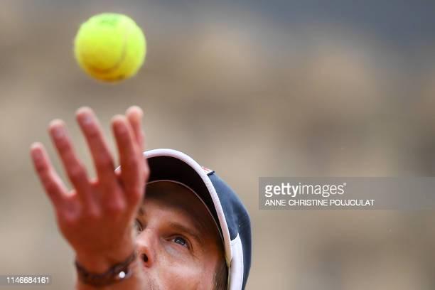 Italy's Andreas Seppi serves the ball to Italy's Fabio Fognini during their men's singles first round match on day three of The Roland Garros 2019...