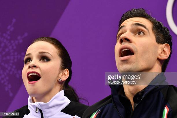 Italy's Anna Cappellini and Italy's Luca Lanotte react after competing in the ice dance short dance of the figure skating event during the...