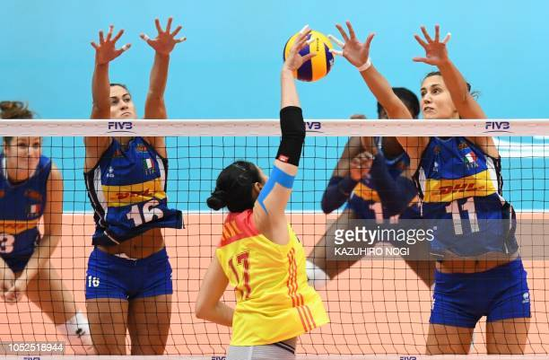 Italy's Anna Danesi and Lucia Bosetti try to block a spike by China's Yan Ni during the 2018 FIVB World Championship volleyball women's semifinal...