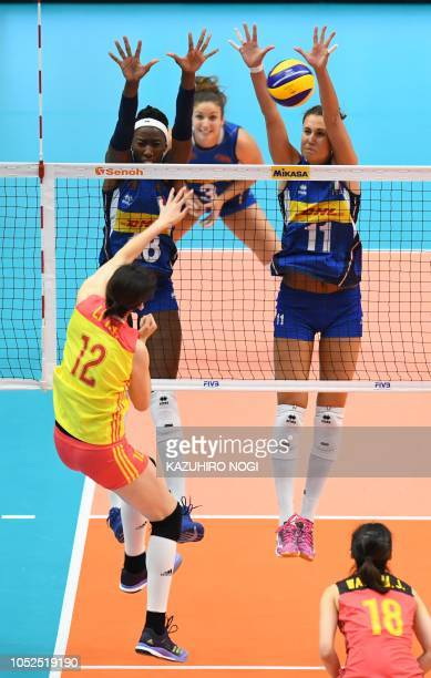 Italy's Anna Danesi and Paola Ogechi Egonu try to block a spike by China's Li Yingying during the 2018 FIVB World Championship volleyball women's...