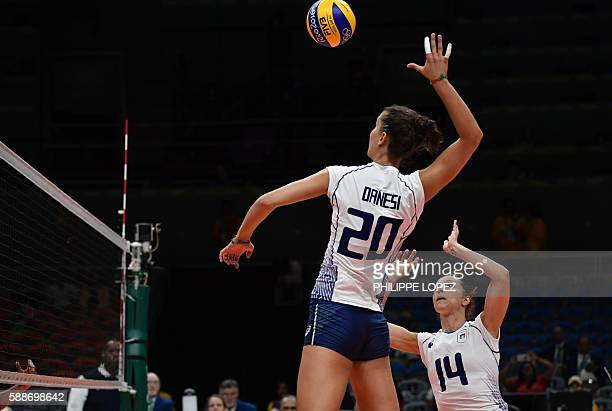 Italy's Anna Danesi spikes the ball during the women's qualifying volleyball match between the USA and Italy at the Maracanazinho stadium in Rio de...