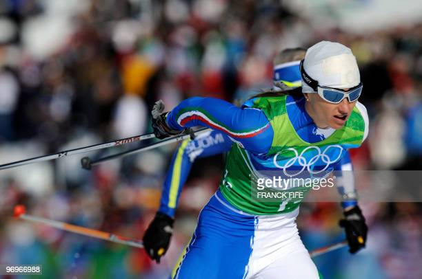 Italy's Arianna Follis competes in the women's cross country skiing team sprint free final at Whistler Olympic Park on February 22 2010 during the...