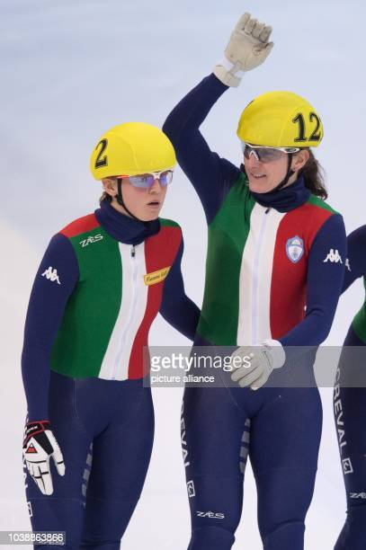Italy's Arianna Fontana and Cecilia Maffei celebrate after crossing the finish line during the women's 3000 m relay final at the ISU Short track...