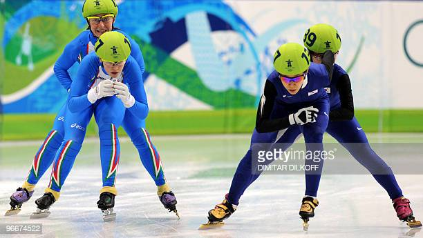 Italy's Arianna Fontana and Cecilia Maffei compete with South Korea's HaRi Cho and MinJung Kim in the Ladies' 3000 m Short Track relay semifinal race...