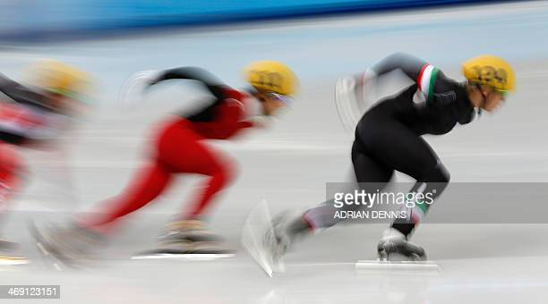 Italy's Arianna Fontana and China's Li Jianrou compete in the Women's Short Track 500 m Quarterfinals at the Iceberg Skating Palace during the Sochi...