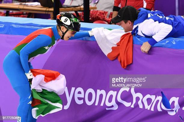 TOPSHOT Italy's Arianna Fontana celebrates winning the gold medal in the women's 500m short track speed skating A final event during the Pyeongchang...