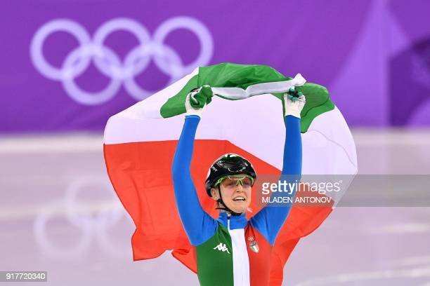 TOPSHOT Italy's Arianna Fontana celebrates winning the women's 500m short track speed skating A final event during the Pyeongchang 2018 Winter...