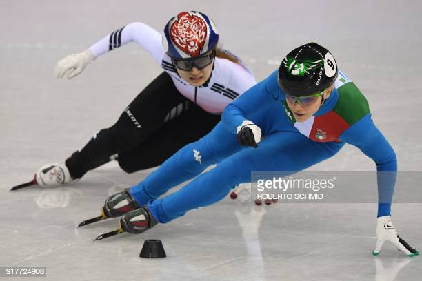 TOPSHOT Italy's Arianna Fontana leads South Korea's Choi Minjeong in the women's 500m short track speed skating A final event during the Pyeongchang...