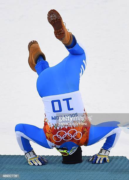 Italy's bronze medalist Christof Innerhofer celebrates during the Men's Alpine Skiing Super Combined Flower Ceremony at the Rosa Khutor Alpine Center...