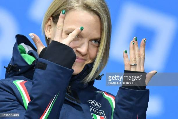 Italy's bronze medallist Arianna Fontana poses on the podium during the medal ceremony for the short track Women's 1000m at the Pyeongchang Medals...