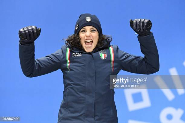 Italy's bronze medallist Federica Brignone celebrates on the podium during the medal ceremony for the women's alpine skiing giant slalom at the...