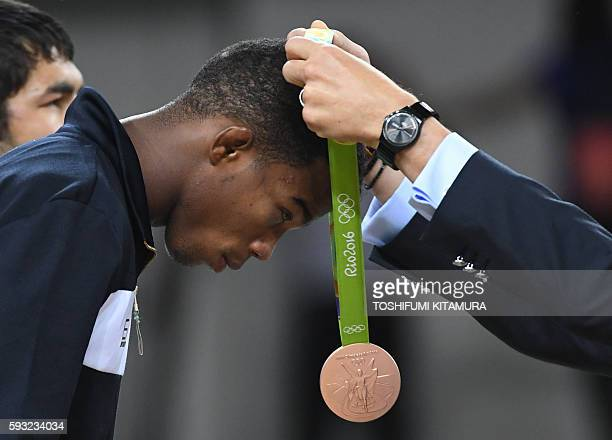 Italy's bronze medallist Frank Chamizo Marquez receives his medal at the end of the men's 65kg freestyle wrestling event at the Carioca Arena 2 in...