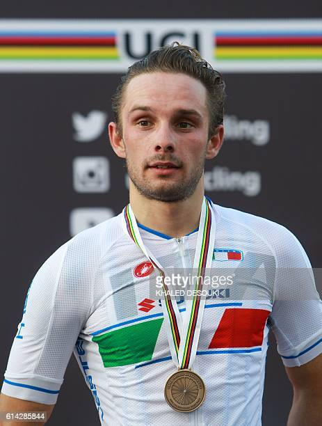 Italy's bronze medallist Jakub Mareczko stands on the podium at the end of the men's under 23 road race event as part of the 2016 UCI Road World...