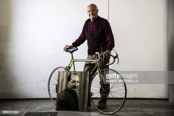 TOUCHOT Italy's Bruno Giannelli teammate of cycling legend Gino Bartali poses with a Legnano's bike and a portrait of Bartali on May 12 2018 at Ponte...