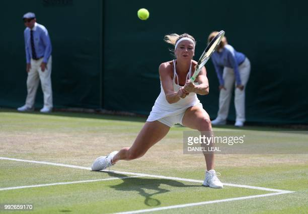 Italy's Camila Giorgi returns against Czech Republic's Katerina Siniakova during their women's singles third round match on the fifth day of the 2018...