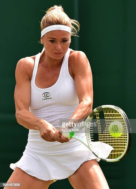 Italy's Camila Giorgi returns against Russia's Ekaterina Makarova during their women's singles fourth round match on the seventh day of the 2018...