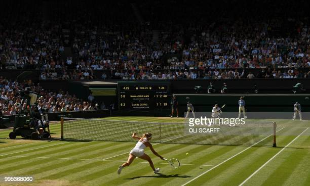 Italy's Camila Giorgi returns against US player Serena Williams during their women's singles quarterfinal match on the eighth day of the 2018...