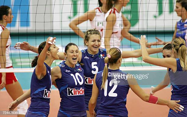 Italy's captain Simona RinieriDennis celebrates their victory with teammates after beating Poland in the second round Pool E match at the Women's...