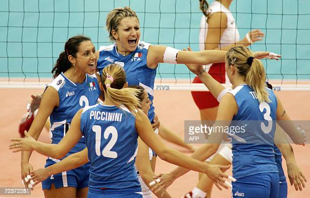 Italy's captain Simona RinieriDennis celebrates with teammates Francesca Piccinini Sara Anzanello and Elisa Togut after scoring a point during the...