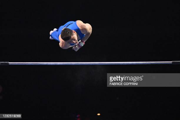 Italy's Carlo Macchini competes in the Men's high bar apparatus final of the 2021 European Artistic Gymnastics Championships at the St Jakobshalle,...
