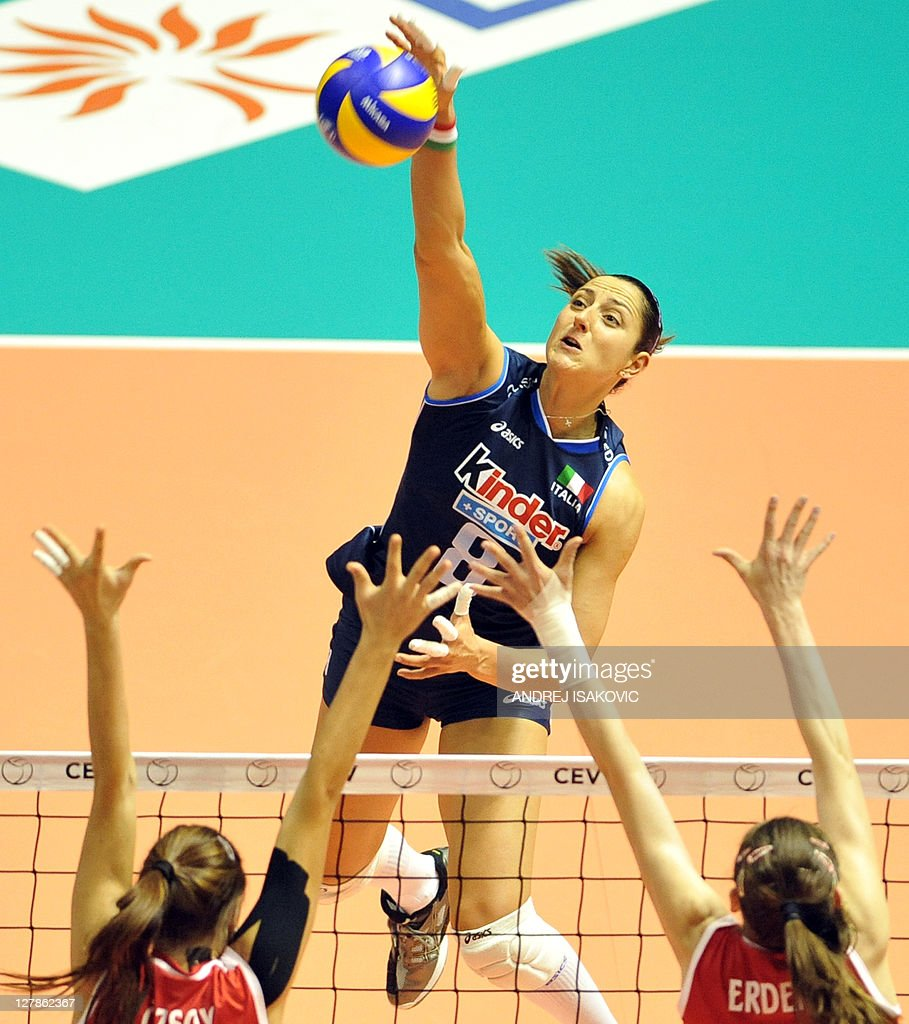 Italy's Carolina Costagrande spikes the ball against ...