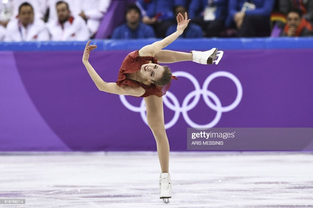 TOPSHOT - Italy's Carolina Kostner competes in the figure skating team event women's single skating short program during the Pyeongchang 2018 Winter Olympic Games at the Gangneung Ice Arena in Gangneung on February 11, 2018. /