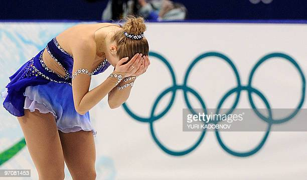 Italy's Carolina Kostner reacts after her Women's Figure Skating free program at the Pacific Coliseum in Vancouver during the XXI Winter Olympics on...