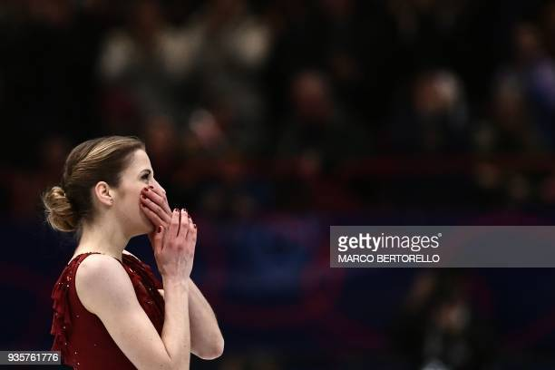 Italy's Carolina Kostner reacts on March 21 2018 in Milan during the Ladies figure skating short program at the Milano World Figure Skating...