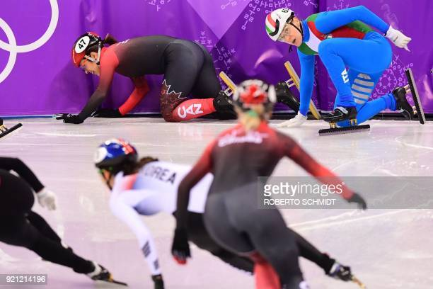 Italy's Cecilia Maffei and Canada's Valerie Maltais fall in the women's 3000m relay short track speed skating A final event during the Pyeongchang...