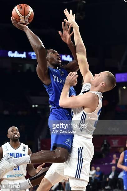 TOPSHOT Italy's center Paul Biligha jumps to score a basket despite of Finland`s forward Erik Murphy during their FIBA Eurobasket 2017 men's round 16...