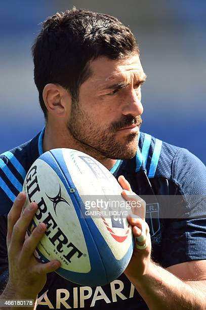 Italy's centre Andrea Masi passes the ball during the captain's run of his team on March 14 at the Olympic Stadium in Rome on the eve of the Six...