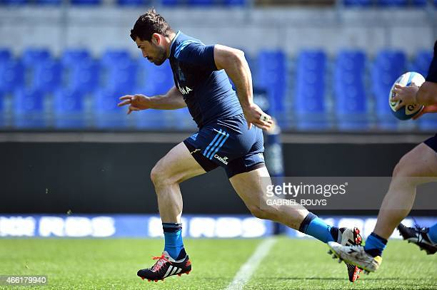 Italy's centre Andrea Masi runs during the captain's run of his team on March 14 at the Olympic Stadium in Rome on the eve of the Six Nations...