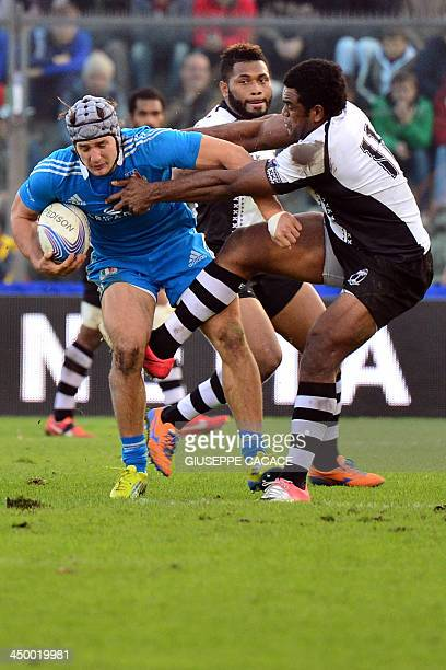 Italy's centre Michele Campagnaro fights for the ball with Fiji's wing Napolioni Nalaga during the rugby test match between Italy and Fiji on...