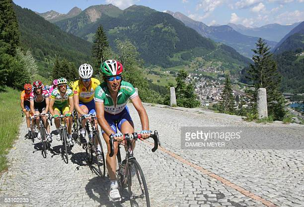Italy's champion Christian Moreni and teammate Australia's Michael Rogers pedal uphill on a cobblestone road during the last stage of the 69th Tour...