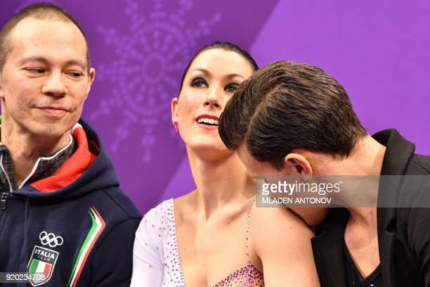 Italy's Charlene Guignard and Italy's Marco Fabbri react after competing in the ice dance short dance of the figure skating event during the...