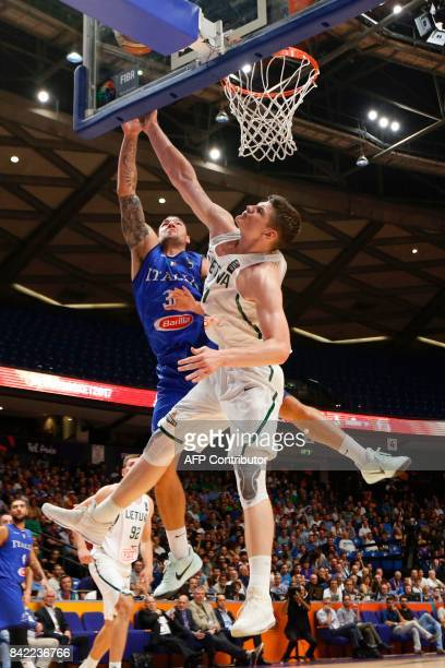Italy's Christian Burns attempts to score as he is marked by Lithuania's Arturas Gudaitis during the FIBA EuroBasket championship basketball match...