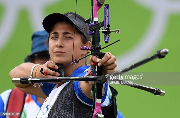 Italy's Claudia Mandia shoots an arrow during the Rio 2016 Olympic Games Women's Team quarterfinal match against China at the Sambodromo archery...