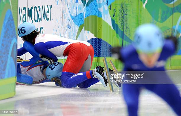 Italy's Claudio Rinaldi and France's Benjamin Mace fall down in the men's 5000m shorttrack relay semifinal at the Pacific Coliseum in Vancouver...