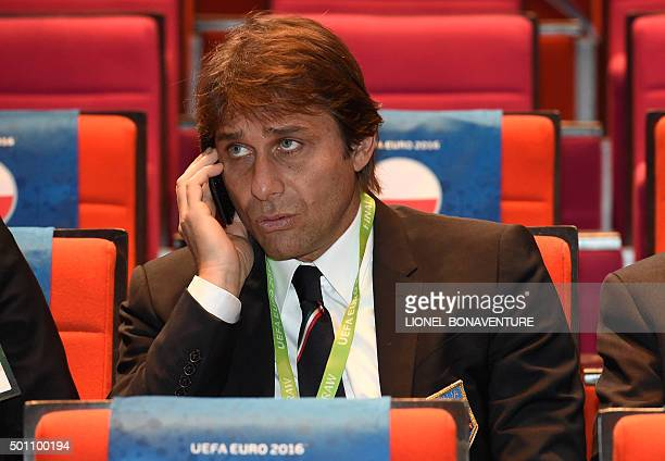 Italy's coach Antonio Conte talks on his mobile phone before the start of the final draw of the UEFA Euro 2016 football tournament in Paris on...