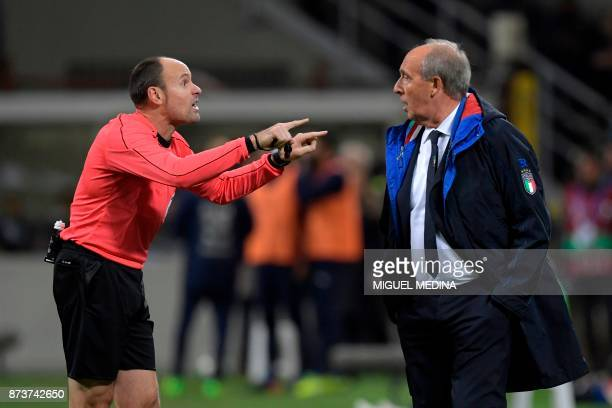 Italy's coach Gian Piero Ventura argues with Spanish referee Antonio Mateu Lahoz during the FIFA World Cup 2018 qualification football match between...