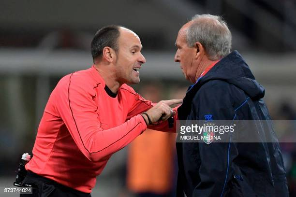 Italy's coach Giampiero Ventura argues with Spanish referee Antonio Mateu Lahoz during the FIFA World Cup 2018 qualification football match between...