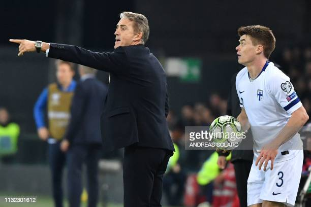 Italy's coach Roberto Mancini gives instructions as Finland's defender Albin Granlund prepares to throw a line out during the Euro 2020 Group J...