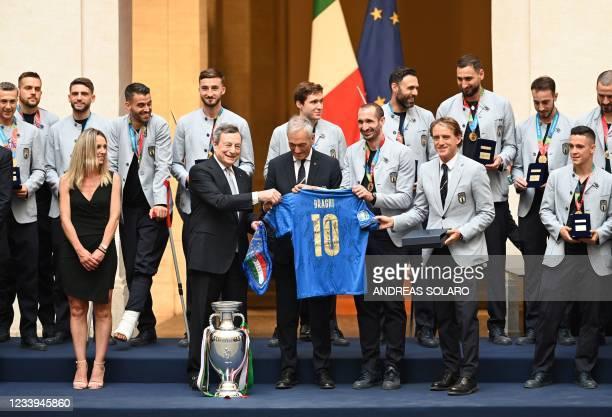 Italy's coach Roberto Mancini , Italy's defender Giorgio Chiellini and President of the Italian Football Federation , Gabriele Gravina present...