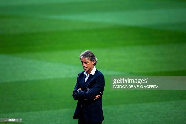 Italy's coach Roberto Mancini stands on the pitch during a walk around the Luz stadium on September 9 2018 on the eve of the UEFA Nations League A...
