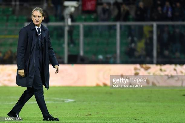 Italy's coach Roberto Mancini walks across the pitch at the end of the Euro 2020 1st round Group J qualifying football match Italy v Armenia on...